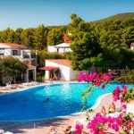 Pool view of Il Borgo of the Palmasera resort among the bougainvillea